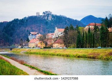Landscape with Savinja River and Celje castle in old town in Slovenia. Architecture in Slovenija. Travel