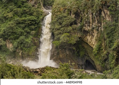 Landscape scene with cascade at the middle of tropical forest in Banos, a touristic place located in Ecuador, South America.