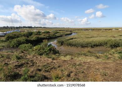 Landscape scene of tidal mud flats and creeks at low water. Blakeney, North Norfolk UK.