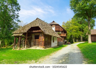 Landscape scenic view of fancy wooden mountain house among big trees in village.