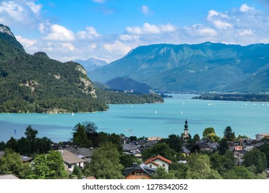 Landscape scenic view on Wolfgangsee lake in Salzkammergut, Austria from a high vantage point. Scenery of St. Gilgen with Alps clear blue water lake amongst mountains during Summer.