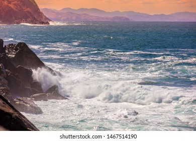 Landscape with sea and cliffs. Rocky seashore on a sunny day. Beautiful nature, landscape, stormy sea. San Sebastian, Basque Country, Spain, Europe