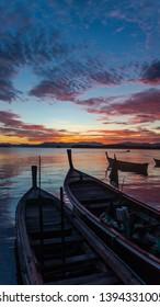 Landscape of sea, fishing boat in the sea at sunrise