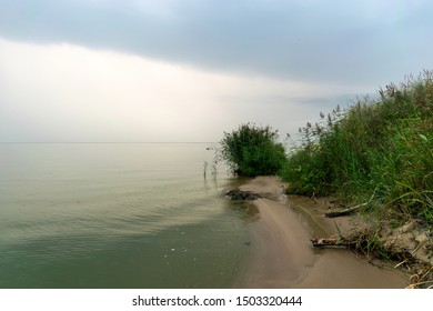 landscape with sea and sand dune shore, shore slip, calm water, Curonian Spit, Nida, Lithuania, Baltic dunes, UNESCO heritage