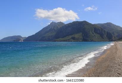 Landscape seashore with mountains on background, Cirali village in Turkey