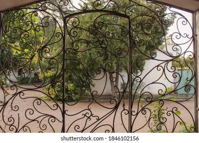 Landscape seen from an old wrought iron gate, for wallpaper