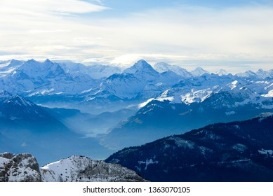 Landscape seen from the top of Mount Pilatus in autumn - Distance view of Berner Alps and Lake Lungern, Canton of Obwalden / Nidwalden / Lucerne, Central Switzerland, Switzerland
