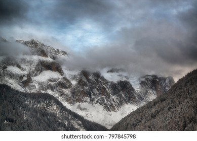 landscape of the Sella Group seen from valley in winter cloudy day