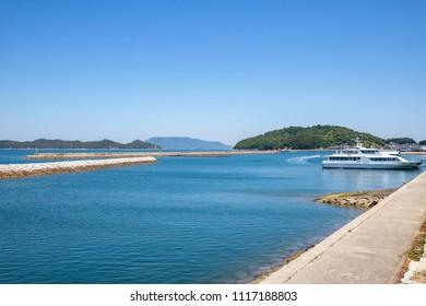 Landscape of the Seto Inland Sea(breakwater and boats in the local port),Aji town,Takamatsu,Shikoku,Japan