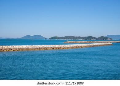 Landscape of the Seto Inland Sea(Oshima island and breakwater in the local port),Aji town,Takamatsu,Shikoku,Japan