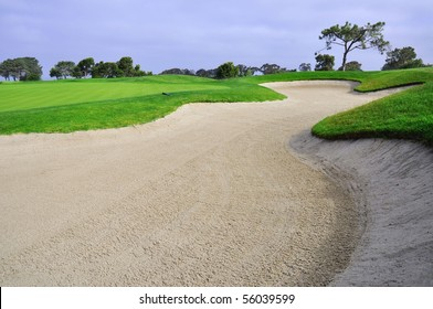 Landscape shot of Golf course with large sand trap.
