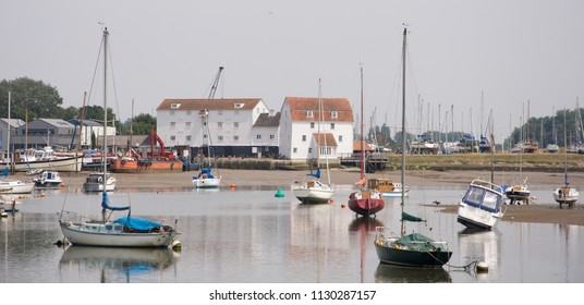 Landscape shot at mid tide showing the Tide Mill at Woodbridge in Suffolk UK which lies on the river Deben