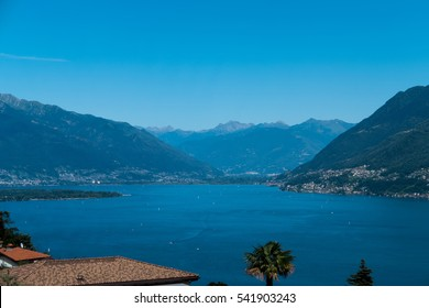 A landscape showing Italy and Switzerland with mountains in the background