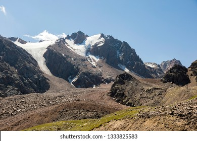 Landscape of Shymbulak Mountains with glacier during the summer, Kazakhstan