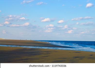 Landscape. Simple image of sandy beach, blue ocean and cloudy sky. Created in Hilton Head, SC. 03/21/2018