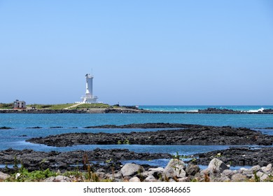 Landscape of Sinchang Windmill Coast with a lighthouse. The coast is famous for driving course because of its beautiful natural scenery with wind generator.