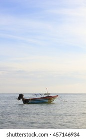 Landscape of sky and sea which has small fishing boat in morning ; southern of Thailand