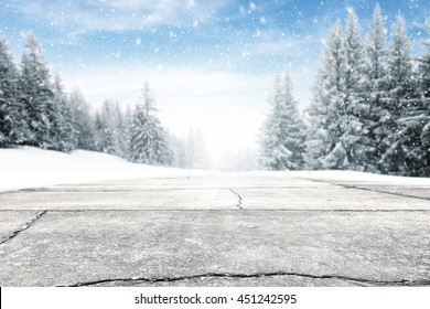 landscape of sky and trees of snow and road