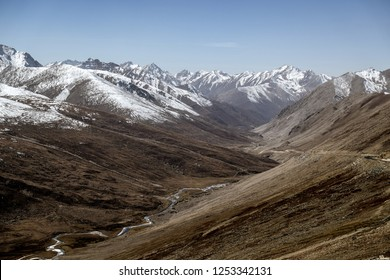 Landscape of snow capped mountain range. A view from Babusar Pass. Khyber Pakhtunkhwa, Gilgit Baltistan, Pakistan