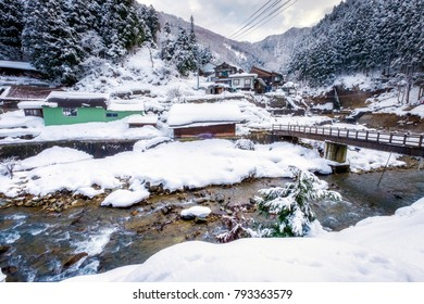 Landscape of snow falling with winter valley view of Jigokudani Wild Monkey Park, Yudanaka, Yamanouchi-machi, Nagano, Japan.