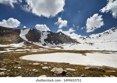 Landscape of snow mountain valley against cloudy sky in Kazakhstan