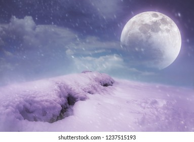 Landscape at snowfall with super moon on sky.