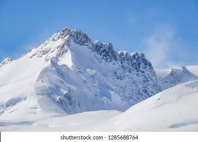 Landscape of Snowy Mountain of Swiss Alps. Gigantic Mountain of Switzerland. Scenic View of Mountain Landscape. Landscape of Snow Mountains from Jungfraujoch, Wengen, Switzerland.