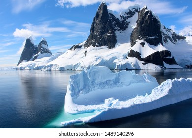 Landscape of snowy mountains and icebergs of the Lemaire Channel in the Antarctic Peninsula, Antarctica