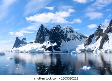 Landscape of snowy mountains and icy shores of the Lemaire Channel in the Antarctic Peninsula, Antarctica
