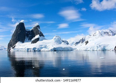 Landscape of snowy mountains of the Lemaire Channel in the Antarctic Peninsula, Antarctica