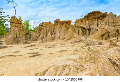 """landscape of soil textures eroded sandstone pillars, columns and cliffs, natural erosion of water and wind, """"Sao Din Na Noi""""or """"Hom Chom"""" and """"Khok Suea"""" at sri nan national park in Nan Province"""