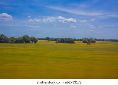 Landscape of the Spanish countryside, seen from the window of a high-speed train