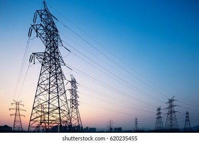 landscape of steel power tower in blue sky at sunrise