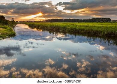 Landscape - storm clouds over the river