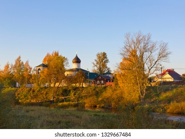 Landscape with sunlit medieval Orthodox church in Pskov, Russia