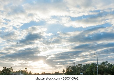 Landscape, sunny dawn in field  with sky clouds background