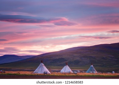 Landscape at sunrise, dwellings of nomads and mountains, Russia, Yamal