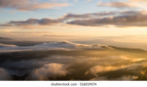 Landscape of  sunrise and moving mist in the mountain and hill . View sunrise  point of mountain at Doi-Montngo, Chiang Mai - Thailand