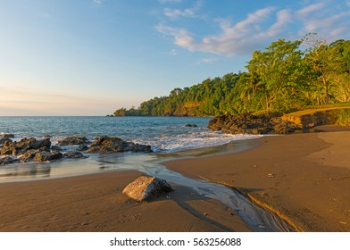 Landscape of a sunset in Costa Rica with its lush jungle vegetation at the entrance of Corcovado national park along the Pacific Ocean.