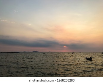Landscape sunset in the ocean and many boat on it in Bangsean Chonburi Thailand