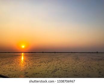 Landscape sunset on ocean when it is tide