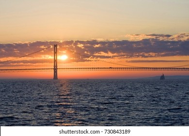 Landscape with sunset over a largest suspension bridge in the Western Hemisphere connected the Upper and Lower Peninsulas of the state of Michigan, USA, between Huron and Michigan Grate Lakes.