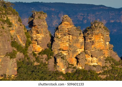 Landscape of The Three Sisters rock formation in the Blue Mountains of New South Wales, Australia, on the north escarpment of the Jamison Valley at sunset.