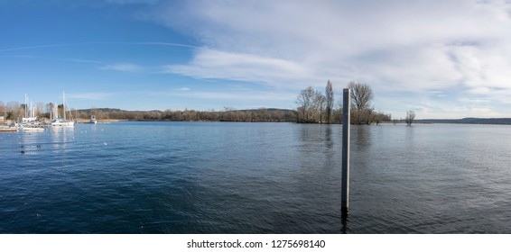 landscape of Ticino river coming out  of Verbano lake, shot in bright winter light at Angera, Verbano, Varese, Lombardy, Italy