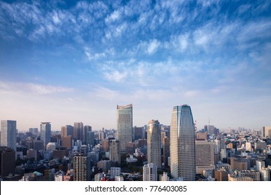 Landscape of tokyo city skyline in Aerial view with skyscraper, modern office building and blue sky with cloudy sky background in Tokyo metropolis, Japan.