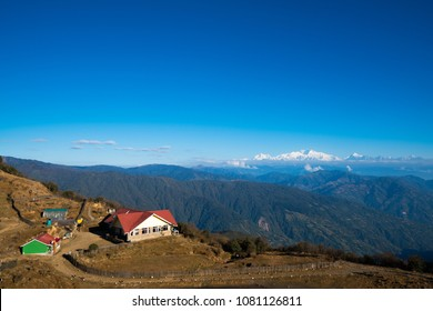 landscape of Tonglu trekkers hut and Kangchenjunga mount during blue sky day time. This place is middle way to Sandakphu, north of India