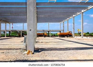 Landscape transform into industrial area, unfinished edifice, under construction, site.