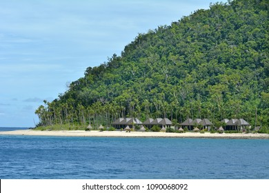 Landscape of a tropical pacific island with empty Bures on one of the Mamanucas islands in Fiji.