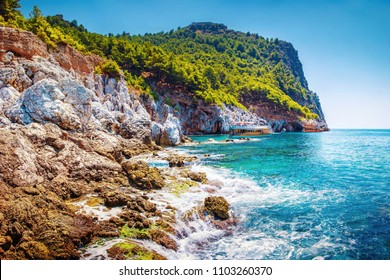 Landscape of tropical rocky coastline on sunny summer clear day. Mountain on sea beach. Tropic nature. Amazing view on rocks and stones in bay of Turkey, Alanya. Perfect warm sea in turkish lagoon