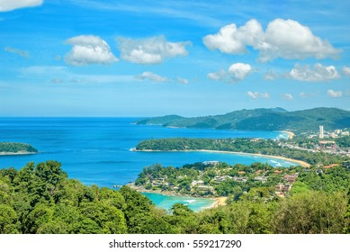 Landscape with turquoise sea, beaches, tropical greenery on the background of blue sky with white clouds. The view from the observation platform of the island of Phuket, Thailand